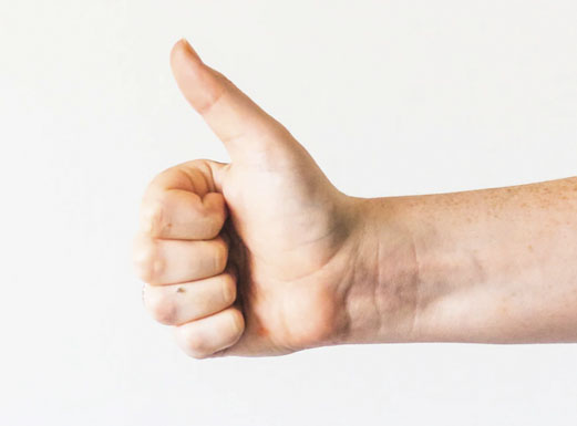 A hand giving a thumbs up.