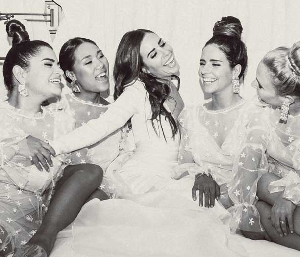 The DSD patient smiling happily with a group of friends on her wedding day.